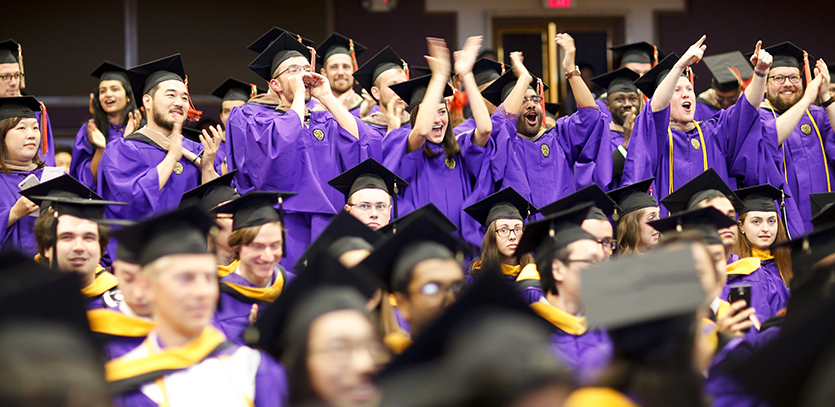 MMM graduates cheer during their Master's Degree Recognition Ceremony.
