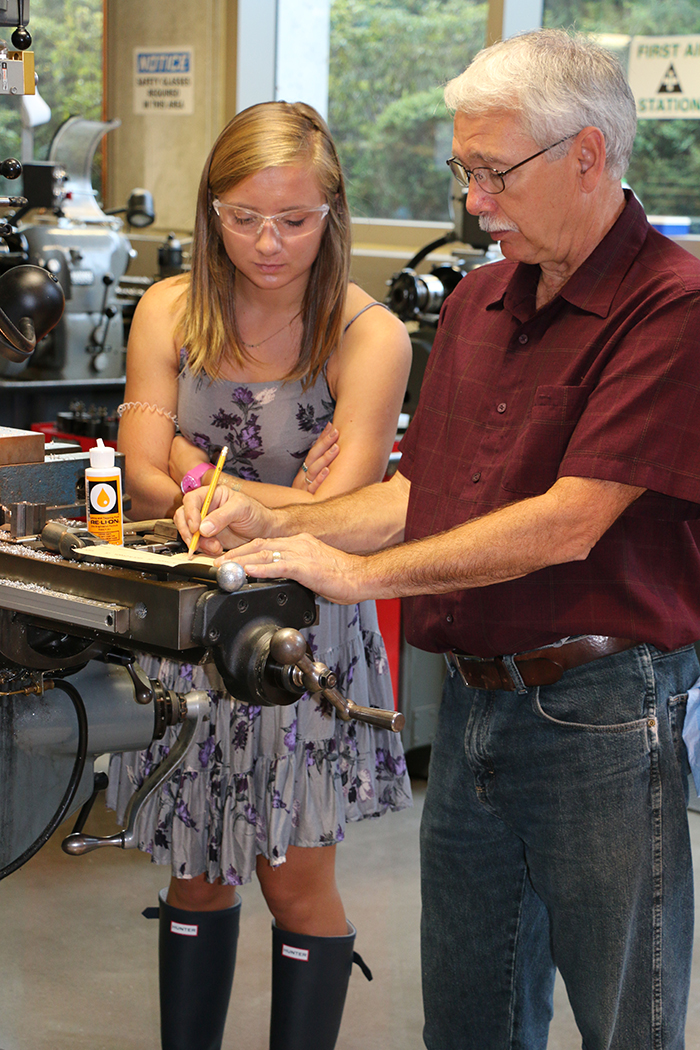 Segal shop manager Scott Simpson helps new EDI Delfina Sitar on her Boot Camp project.