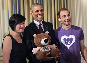 Chung and Horowitz pose with President Obama and Jerry the Bear, their smart stuffed animal that teaches healthy behaviors to children.