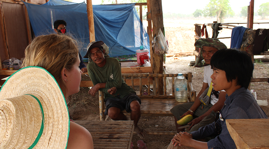 A member of the CattleTECH team speaks with farmers in Thailand.